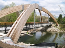 Conceptual and final design for the arches, Glue-Laminated timber design, Erection stability analysis, Detail preparation for arches and quality control review for remaining structure